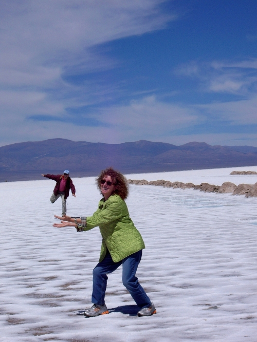 My mom and dad, playing with optical illusions on the salt flats of Argentina